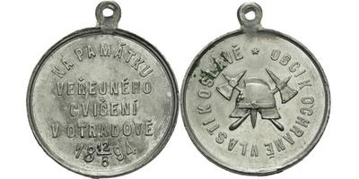 AE Medaile 1894 - Na památku veřejného cvičení. 4-řádkový nápis a datum. Přilba a zk